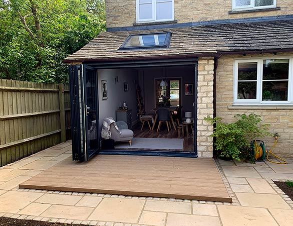 Bi-fold doors extension with patio and decking